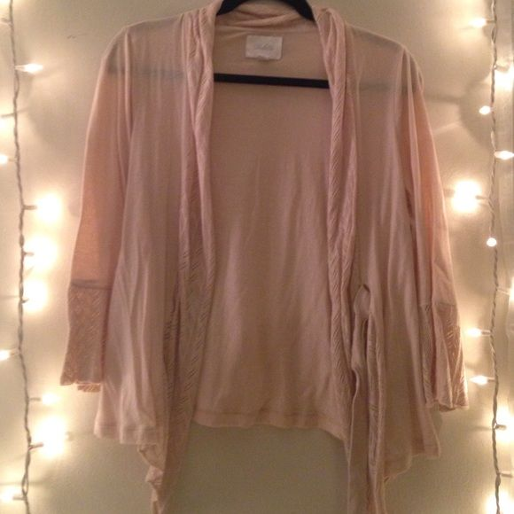 Nude wrap cardigan with lace detail! Large nude cardigan with bell sleeves. Wrap detail around waist and lace around neck and sleeves. Looks great with a tshirt and jeans or over a dress! Fits small Deletta Sweaters Cardigans