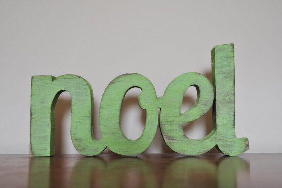 Christmas Wood Word Noel Decoration. $30.00, via Etsy.
