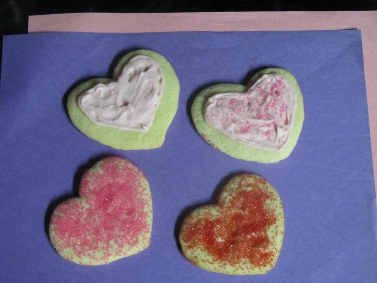 Decorated sugar cookies for Valentine's Day Promo. Frosted cookies have raspberry flavored frosting on them.