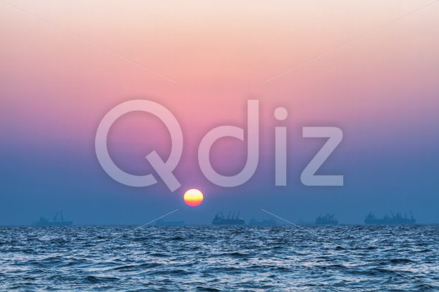 Qdiz Stock Photos | Sunset over sea,  #arabian #awe #backdrop #background #beautiful #color #dusk #environment #evening #eventide #flowing #glow #heat #horizon #idyllic #leisure #ocean #reflection #romance #romantic #scene #sea #seascape #serenity #sky #space #summer #Sun #sunlight #Sunset #sunshine #surf #surface #tide #tranquil #Travel #twilight #vacation #view #water #wave #yellow