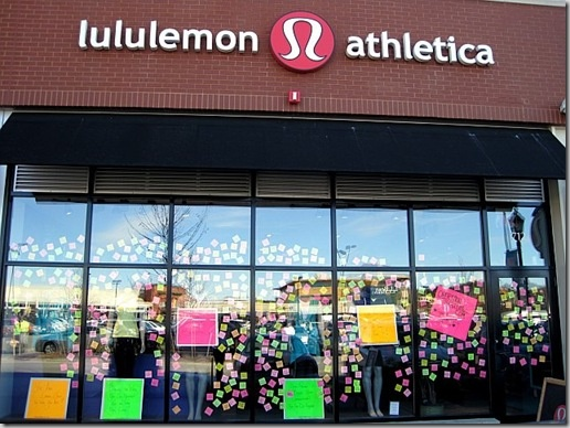 This is an example of a Lululemon store window displaying apparel and also giving customers a chance to participate in the design process