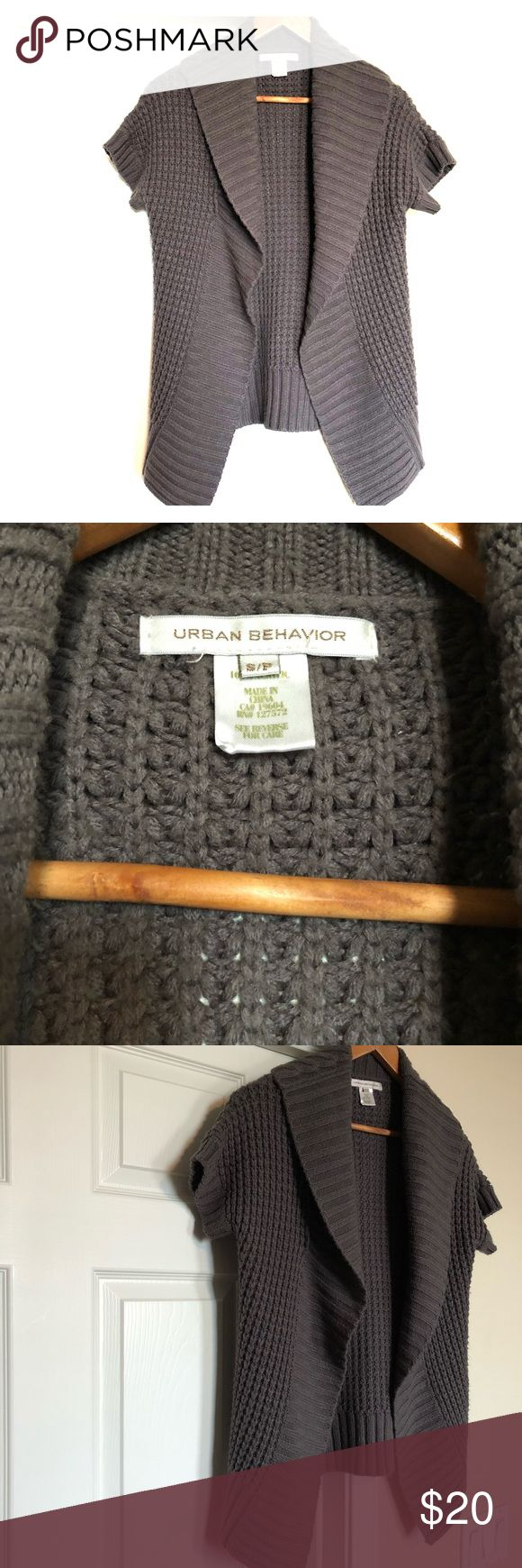 Gray short sleeve Urban Behavior sweater This sweater is very comfortable and can be worn so many ways. It can be worn with a belt around the waist, left open with a tank underneath, worn over a dress, with a tunic and tights and boots. So many options!   This sweater is in great condition! I do accept reasonable offers! I would be happy to answer any questions you may have! Urban Behavior Sweaters