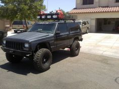 lifted xj with roof rack | XJ roof Basket - Jeep Cherokee Forum