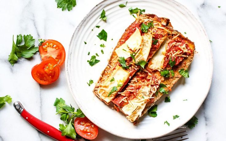 <p> Instead of bread crumbs, this eggplant Parmesan is coated in herbed almond meal that browns beautifully in the oven. Then, it is covered in savory tomato sauce, vegan mozzarella, and baked again until warm, bubbly, and melty.</p>