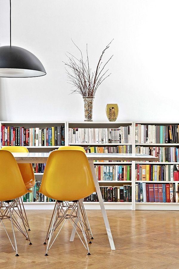 Yellow Eames chairs + low book shelves. Rörsjöstaden, Malmö.