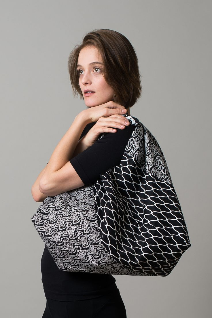This classic Japanese bag, in a style called azuma-bukuro, ties at the top and is traditionally made from one piece of fabric. The Azuma bag is versatile and roomy - it can be used as a handbag or to carry shopping. The fabric is hand-dyed in Japan.