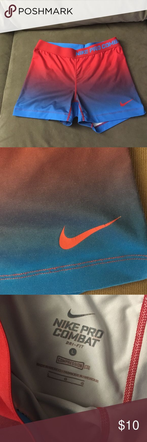 Nike Pro Combat Shorts Size Large Great condition. The swoosh has cracking as shown in pictures. Cute ombré color. Lowest offer is the price listed. No trades or Mercari. Price firm unless bundled. Nike Shorts