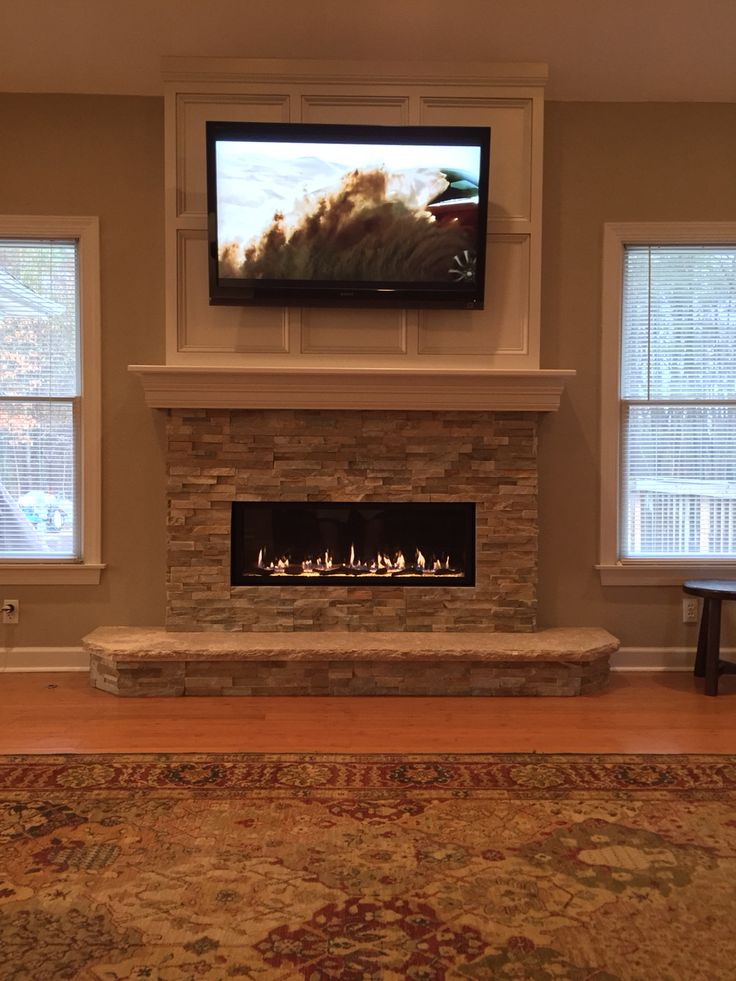 Linear fireplace with tv