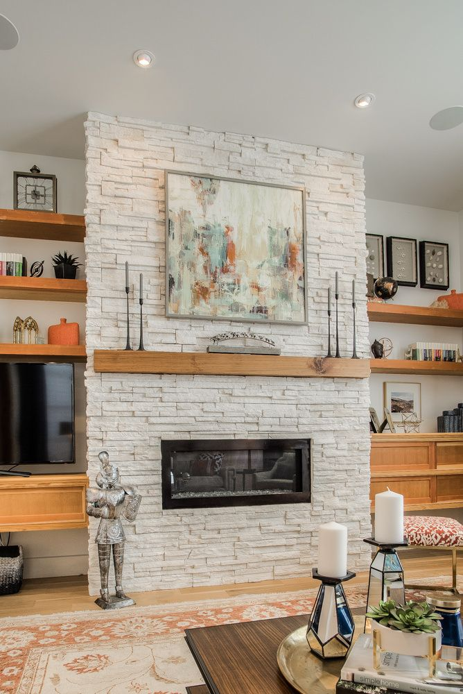 Warm and Inviting Fireplace design using off-white stacked ...