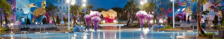 """Disney's Art of Animation """"Finding Nemo"""" pool. A nighttime view of Finding Nemo pool at Disney's Art of Animation Resort with colorful play areas. Contact Personal Travel today to learn more. rachel@personaltravelonline or 1-877-484-2835"""