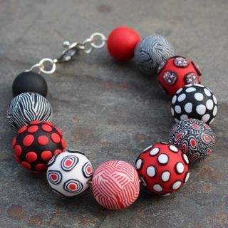Polymer Clay beaded bracelet - Eleanor Watson 2013. A study in red, white and black clay only - fun to work with a limited palette!