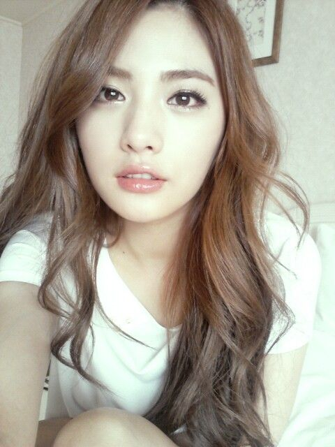 After Schools Nana is a flawless beauty in a simple white t-shirt