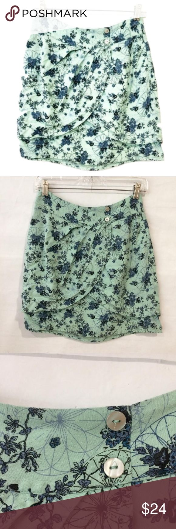 UO Kimchi Blue Tulip Floral Skirt Mini skirt with a light green-blue floral pattern, and a tulip hem detail at the front. Approximately 16 inches in length and size 4. Two buttons at the front, decorative. From Urban Outfitters. In great condition. Smoke free home and fast shipping. Urban Outfitters Skirts Mini
