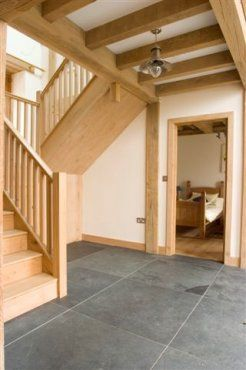 Make a small space feel larger with large slate flagstone floor. Roderick James Architects.