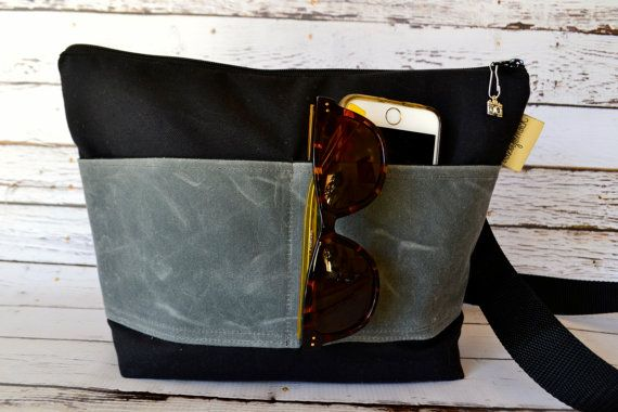 The mack sack for your camera and lens Created in Black Canvas & Gray waxed Canvas  Zipper close Secure your camera equipment in your favorite Purse