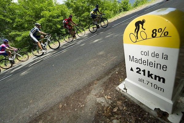 "#tdf 2012 Mountain Madness: ""The leading men ride past a road sign announcing 8 per cent of climb for the Col de la Madeleine. Photo: AFP"" The camera angle shows a 45% gradient :-)"