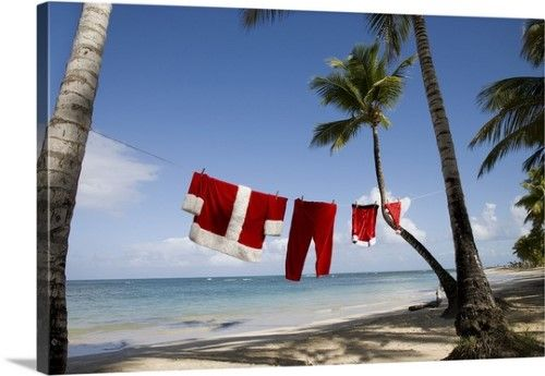 Premium Thick-Wrap Canvas Wall Art Print entitled Santa Claus costume hanging on clothesline on tropical beach, None