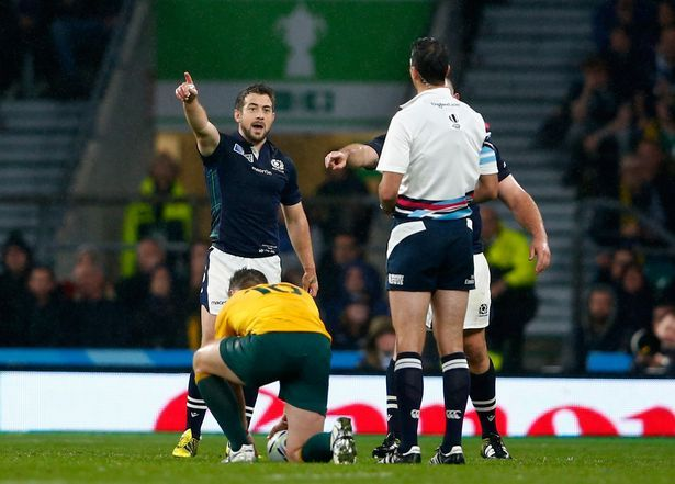 South African Referee Craig Joubert being confronted by Scotland's Greig Laidlaw after awarding a penalty kick to Australia in match which saw Scotland exit Rugby World Cup