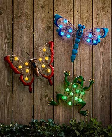 This delightful Solar Garden Wall Hanging is embellished with large lights that provide a burst of illumination at night.