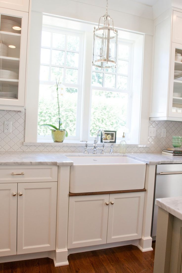 The Granite Gurus: Carrara marble Kitchen.   I love the millwork on sinkbase