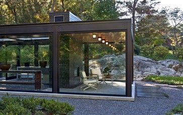 Steel frame glass house with living area, modern gas fireplace and greenhouse | Flavin Architects