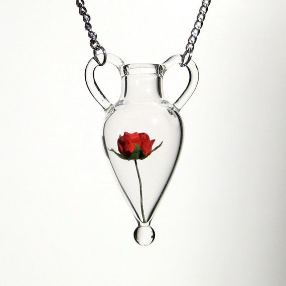 Elegant pendant necklace of an amphora bottle and rose.  I am utterly charmed at the handcrafted beauty of it.