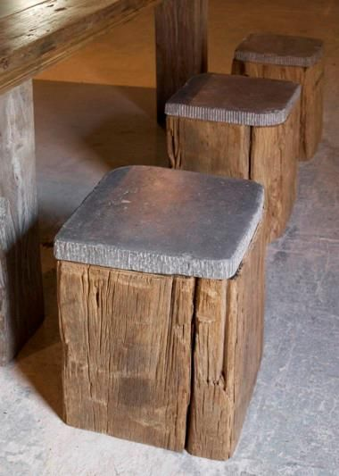 Very cool stools: rough chunks of wood topped with stone.