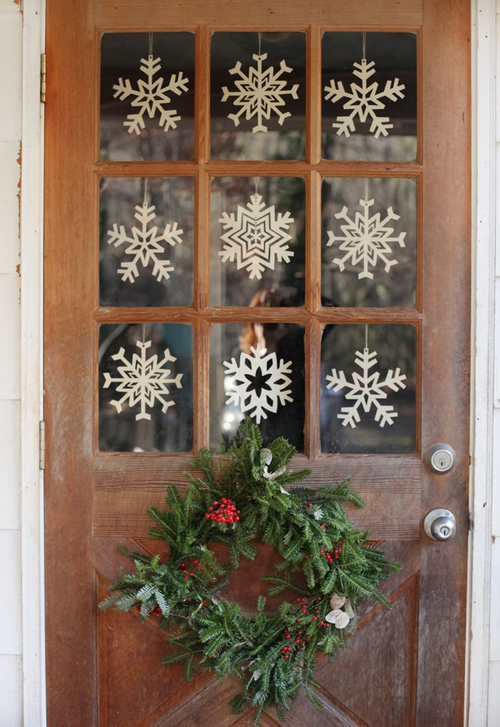 Paper snowflakes in the windows - Wreath on the door