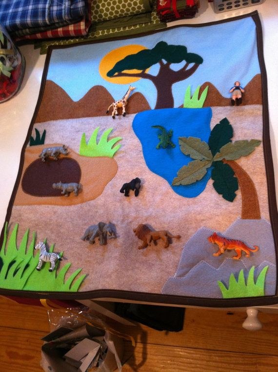 Hey, I found this really awesome Etsy listing at https://www.etsy.com/listing/175280232/felt-safari-playmat-a-roll-up-safari