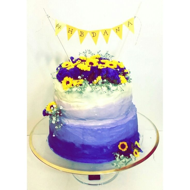 Purple Ombre Cake with yellow bunting and fresh flowers! My favourite cake project yet!