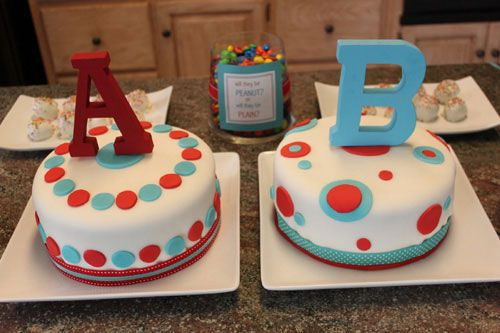 gender reveal cake - this would be cute for twin gender reveal... i also like the primary colors for the design & then the cake/icing inside revealing color - good if mom isn't a fan of pastels