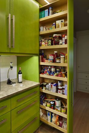 Milton worked in this pullout pantry, which, while taking up hardly any space on the exterior, has plenty of space among its eight shelves i...