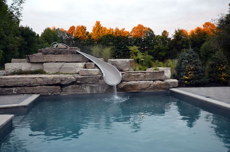 Now that's a beautiful backyard scene. Who doesn't love a water-slide, with stunning fall colours in the background!