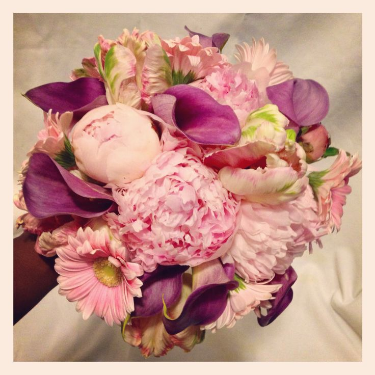 Bridal bouquet containing Peonies, Dutch tulips, calla lilies, and mini Gerber daisies