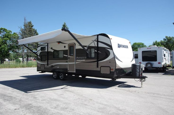 "AFFORDABLE FAMILY VACATION MOBILE!!!  2015 Prime Time Avenger 26BH This used bunkhouse is clean and in great shape! With a large double bunk in the rear, a master bedroom in the front, and both a sofa and dinette that turn into beds you'll have tons of sleeping space! Relax together as a family and enjoy a movie in the flat screen TV in the living area. This rig is 28' 11"" long and has a dry weight of 4,850 lbs!  Give our Avenger expert Mike White a call 231-903-6220 for pricing and more…"