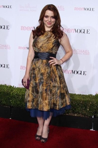 Jennifer Stone Lookbook: Jennifer Stone wearing Cocktail Dress (1 of 2). Jennifer showed off her tulle embellished abstract print dress while hitting the Teen Vogue party.