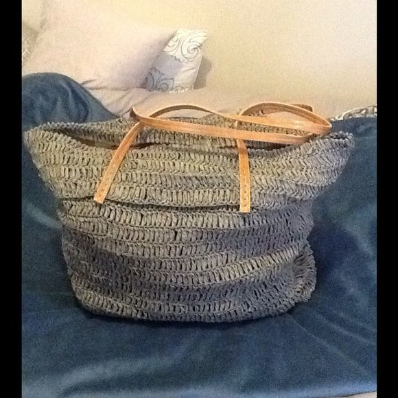 Shiraleah Lt. Grey Grass Woven Beach Bag This Large beach or duffle bag is fully lined with fun colors! One zip pouch and two slots for phone, etc. Long cognac straps! Shiraleah Bags
