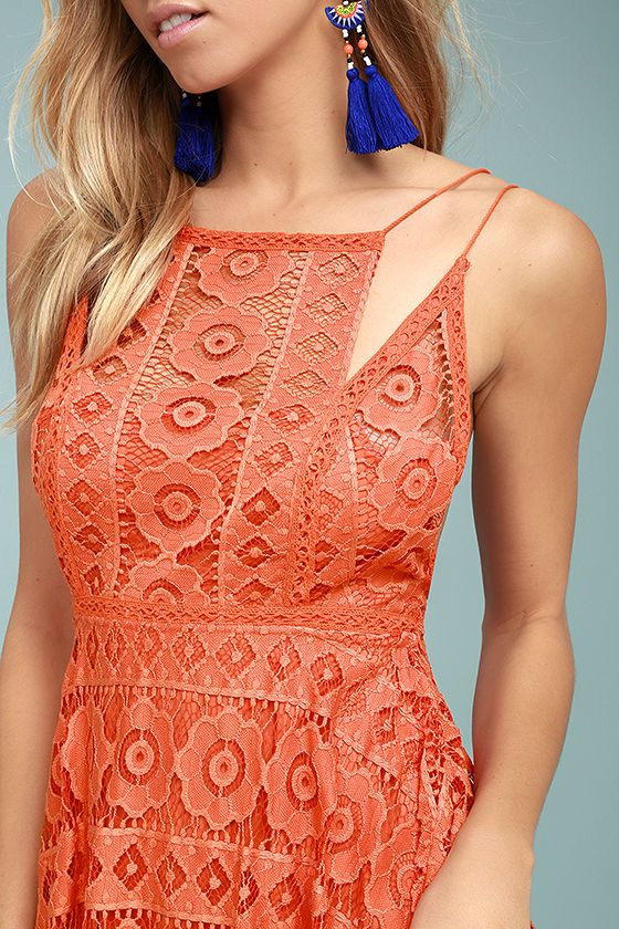 The Free People Just Like Honey Coral Orange Lace Dress is as sweet-as-can-be! Romantic lace overlay forms this sleeveless dress with a unique, high neckline, and crochet lace princess seams. Skirt falls to a flirty length with handkerchief hem. Braided double straps and hidden back zipper/clasp.