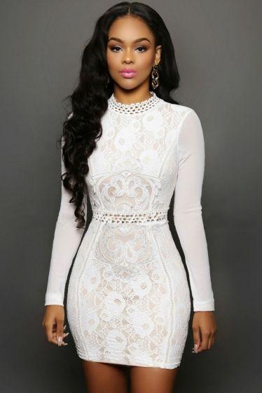 Biała sukienka z koronki z tiulowymi rękawami. Koronkowe białe sukienki.