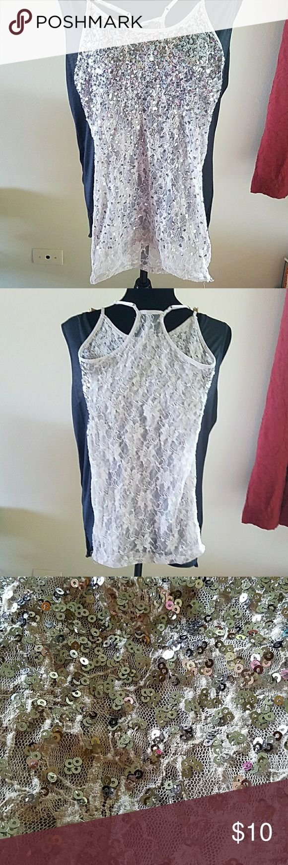 Sheer sparkle top! This is a perfect party Short! Mauve colored lace with silver sparkle sequins and a razorback. Wore this a few times and there is a little sign of wear on the lace, but still lots of life left! Charlotte Russe Tops Tank Tops