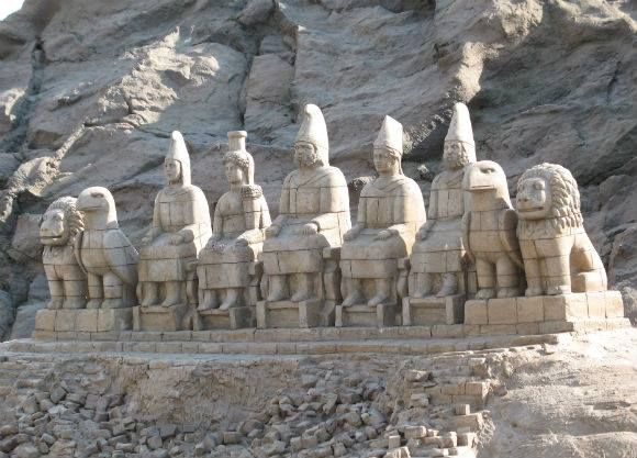 Monumental statues of the Pantheon of the Armenian Gods at Mount Nemrut. From Left to Right . Lion, Eagle, Tir, Anahit, Aramazd, Mihr, Vahagn, Eagle, Lion.  Nemrut is named after the story of Hayk and Bel Nemrod.
