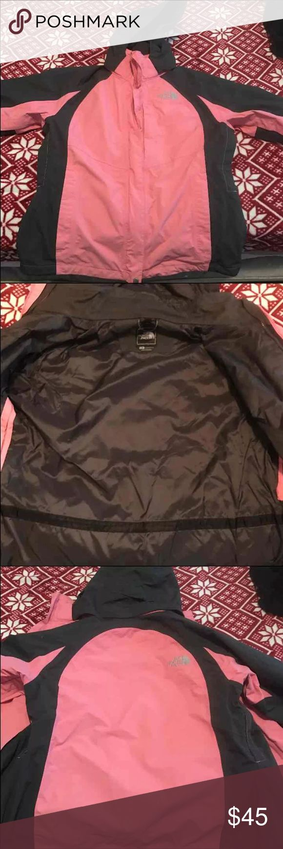 Women's north face jacket It is more heavier than a lot of rain jackets. It is in good condition. The only thing is a small mark on picture 4. It might be able to come off. Selling as it is. It is a dark gray and pink color. The North Face Jackets & Coats