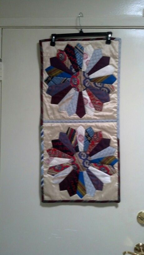 Made for my neighbor when her husband died from his ties as a memory piece.