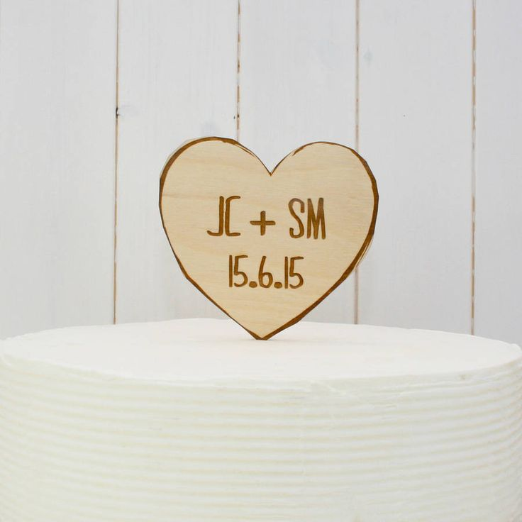 A wooden love heart cake topper, engraved with your choice of initials and dateChoose a colour from the drop-down menu.  If there's a specific colour you'd like to match the colour theme of your wedding day and it's not on our list, do please send us a message as we're always happy to discuss your exact requirements. Inspired by the love heart sweets we loved as children, these cake toppers will add a touch of fun to your wedding cake. Or a pefect addition to any occasion or celebration…