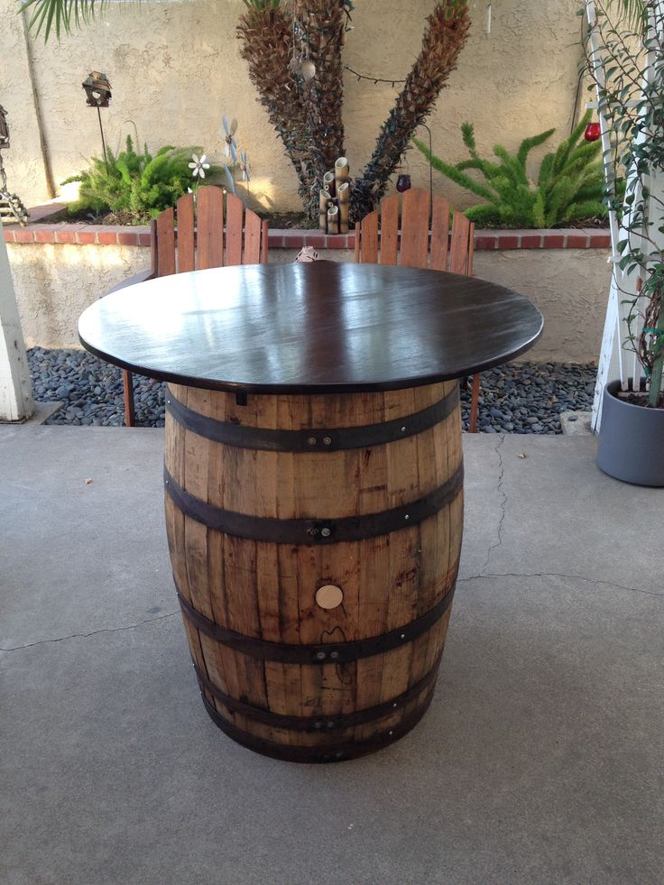 whiskey barrel turned into a backyard cocktail table. Black Bedroom Furniture Sets. Home Design Ideas