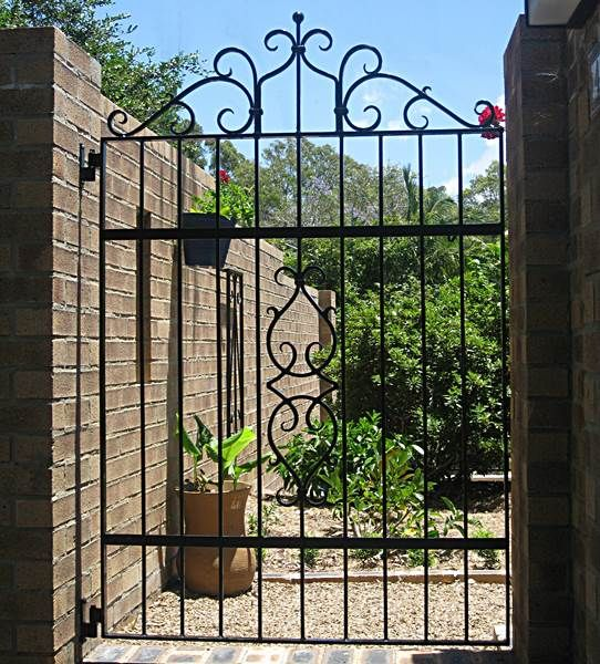 This gate has hand forged wrought iron which was made to match an antique piece of wrought iron from New Orleans. Buderim, Qld