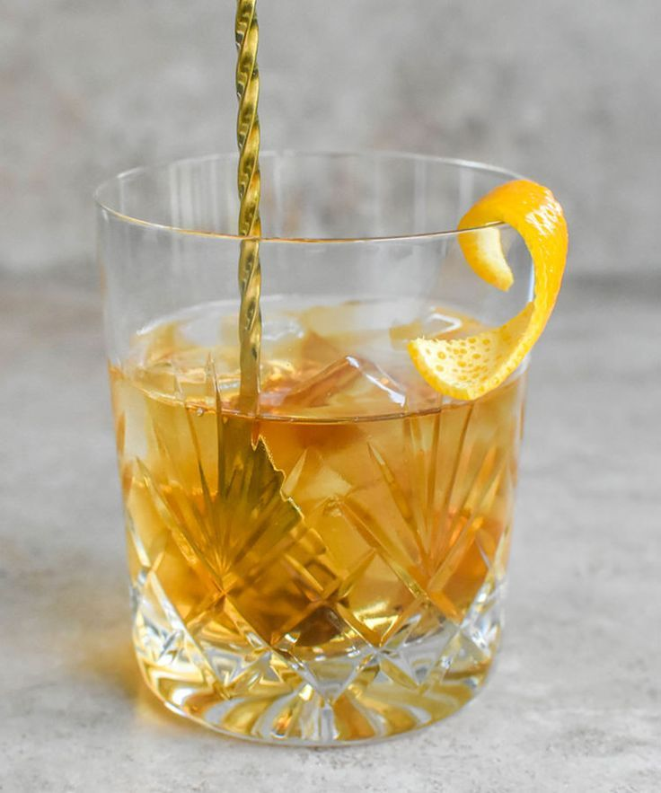 The Orange Old Fashioned Recipe - In this Old Fashioned, Grand Marnier adds warm orange notes to the mix, offsetting the spice of the rye. It's a great way to introduce autumnal flavors to a timeless drink. {wine glass writer}