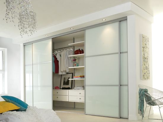 Simple yet effective soft white glass sliding wardrobe for 4 door wardrobe interior designs