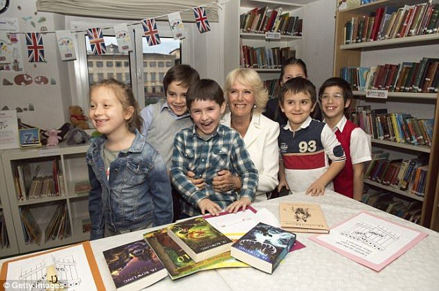Camilla meets Italian children who are learning English at the British Institute in Floren...