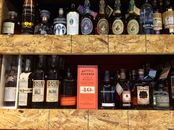 Batch 13 liquor and wine shop in Washington's trendy 14th Street corridor is expanding its shelf space to make room for n even wider stock of high-end bourbons and other spirits. But as the focus -- and shed space -- is increasingly turned over to premium bourbon, have we forgotten old standbys that remain worth the pour? Above, Four Roses is the welcome exception to the rule. (Photo by Michael Lindenberger / BourbonStory.com.)